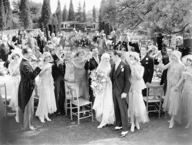 Wedding party toasting to the bride and groom