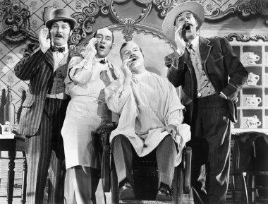 Four men at a barber shop singing