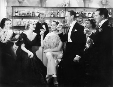 Elegant group of at a bar toasting a woman