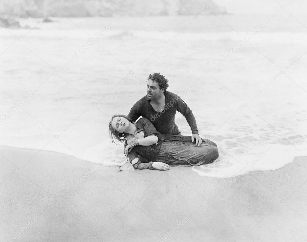 Man rescuing woman from ocean