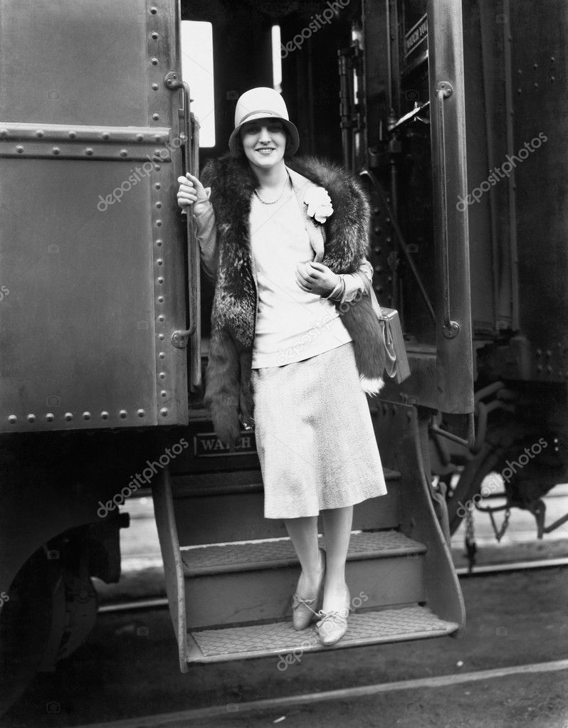 Woman getting off the train
