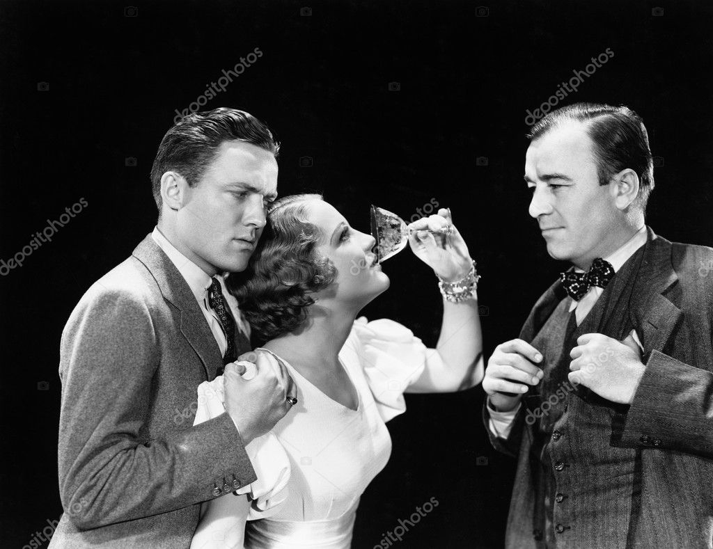Two men supporting a woman drinking
