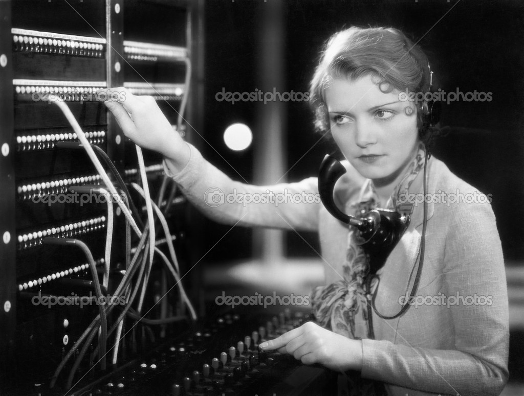 Young woman working as a telephone operator