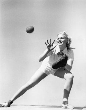 Woman catching a baseball