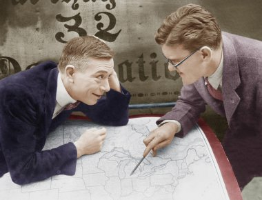 Excited businessmen meeting with map