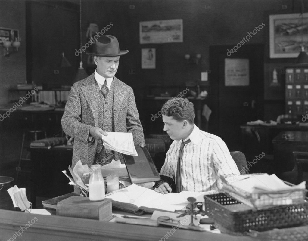Man with attitude showing papers to office worker