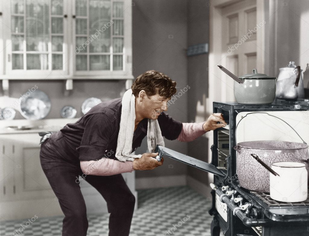 Man looking into oven