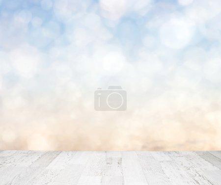 Blue sky behind wooden floor