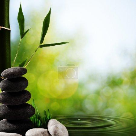 Photo pour Horizons spa asiatique abstrait avec bambou et galets - image libre de droit