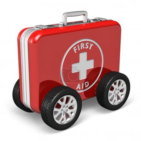 Photo pour Concept de l'assistance médicale : cas rouge avec trousse de premiers soins avec des roues de wagon isolé sur fond blanc - image libre de droit