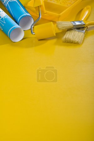 Paint tools on yellow background with copyspace