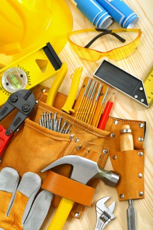 Big composition of working tools on wooden boards
