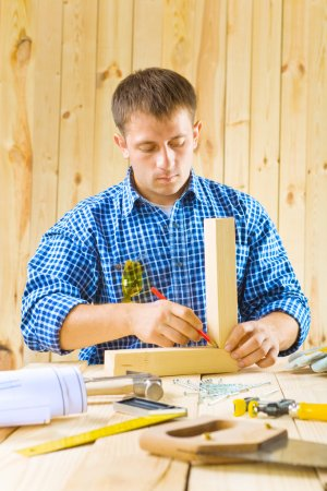 Photo for Carpenter does works with pencil - Royalty Free Image