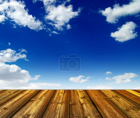 Blue sky and wood floor background