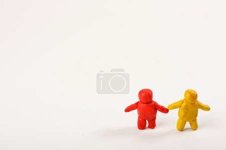 Two Plasticine men. standing isolated on white background