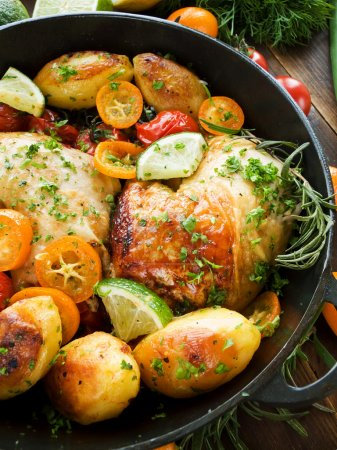 Photo for Frying pan with roasted chicken, vegetables, herbs and fruits. Shallow dof. - Royalty Free Image