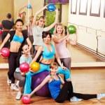 Women group in aerobics class. Fitness ball....