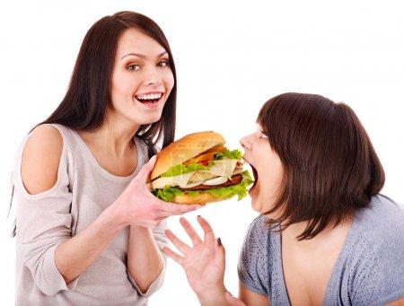 Photo for Women eating hamburger. Isolated. - Royalty Free Image