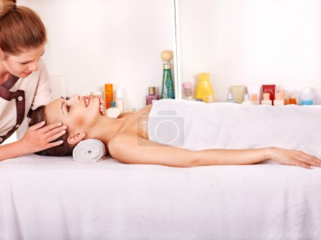 Photo for Woman getting facial massage in beauty spa. - Royalty Free Image