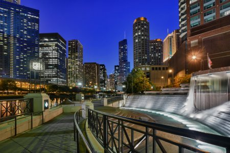 Photo for Floodlit Centennial Fountain and river side walk in Chicago at night - Royalty Free Image
