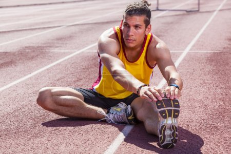Photo for Track and Field Athlete Stretching - Royalty Free Image