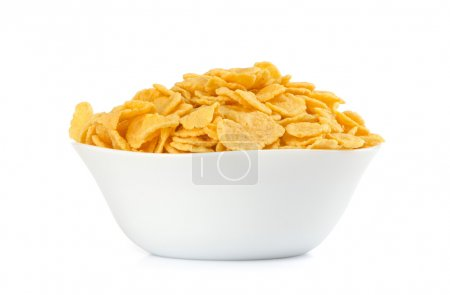 Photo for Corn flakes in a bowl against white background - Royalty Free Image