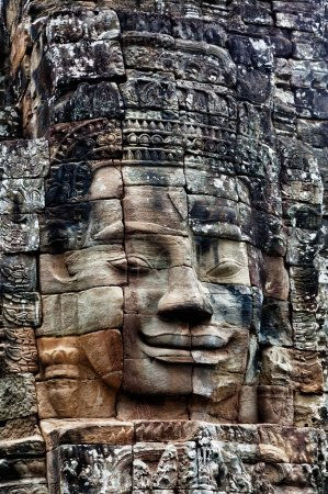 Stone bas-relief of Buddha in the temple of Angkor Thom.