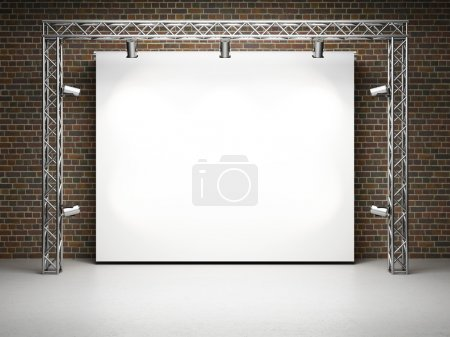 Photo for Blank trade exhibition stand with screen and spot lights on brick wall - Royalty Free Image