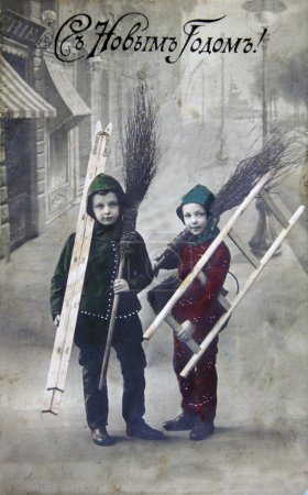 Boys with brooms and ladders against the background of the stree