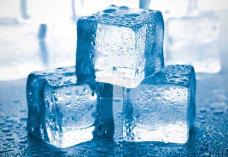 Photo for Melting ice cubes on glass table - Royalty Free Image