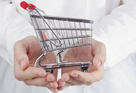 Photo for Close-up photograph of man's hands holding a shopping cart. - Royalty Free Image