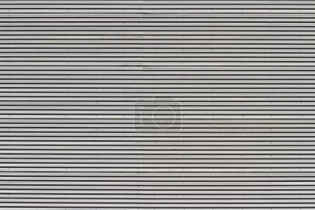 Photo pour Surface en métal ondulé avec rivets - image libre de droit