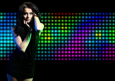 Fashion expressive girl dancing at disco light