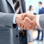 Handshake in front of business...