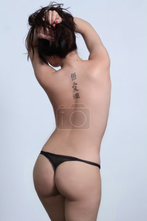 Female back with tattoos