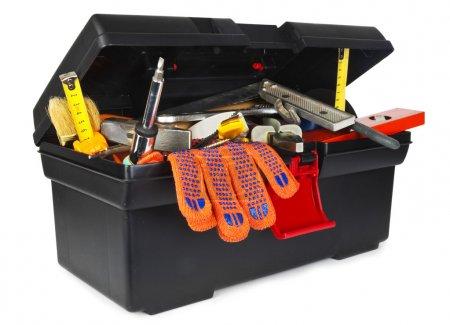 Foto de Caja de herramientas con instrumentos sobre fondo blanco - Imagen libre de derechos