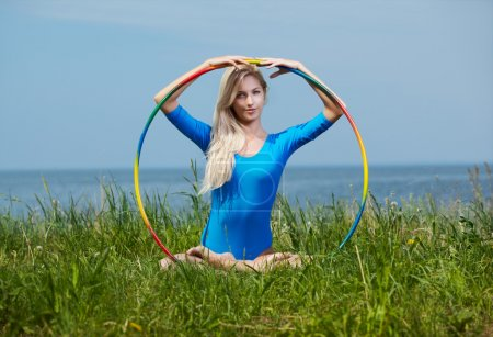 Blonde girl gymnast outdoors