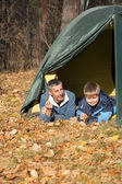Tent in autumn forest