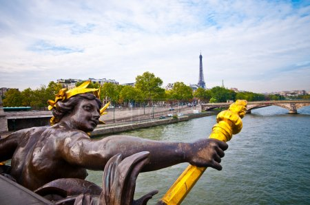 View on Seine River and Eiffel Tower from Alexander III bridge i