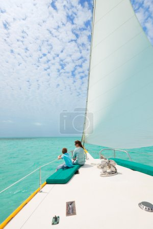 Family sailing on luxury yacht
