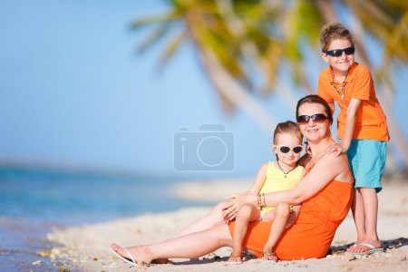 Photo for Beautiful mother and two kids enjoying beach vacation - Royalty Free Image