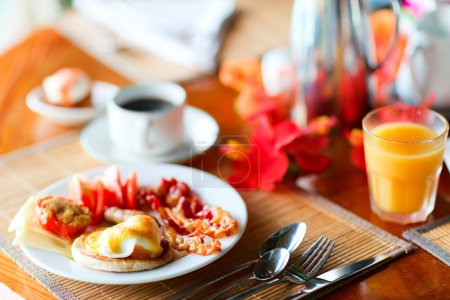 Photo for Delicious breakfast with eggs Benedict, bacon, orange juice and coffee - Royalty Free Image