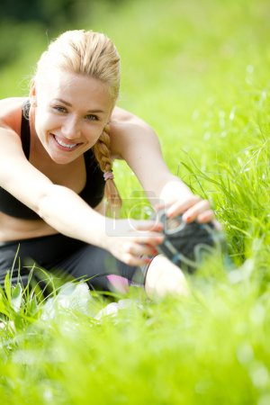 Photo for Attractive Woman stretching before Fitness and Exercise - Royalty Free Image
