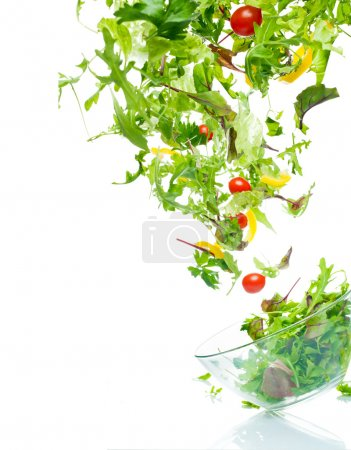 Photo for Flying salad. Isolated over white. - Royalty Free Image