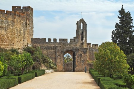 Photo for The entrance to the fortress of the Knights Templar. Fortress protective wall surrounding the dilapidated medieval castle Templar - Royalty Free Image