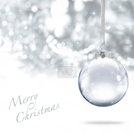 Photo for Merry Christmas glass ball against silver background - Royalty Free Image