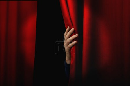 Photo for Girl open a red curtain - Royalty Free Image