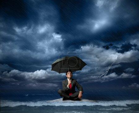 Businessman on a raft