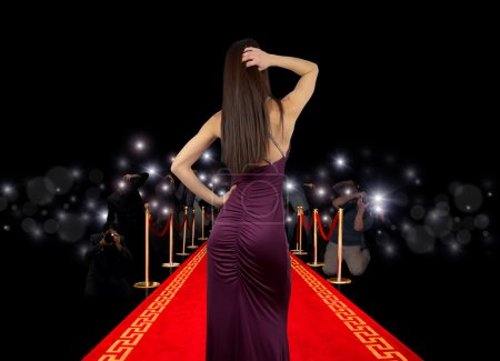 Photo for Celebrity on red carpet with photographer - Royalty Free Image