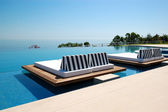 Infinity swimming pool by beach at the modern luxury hotel, Pier